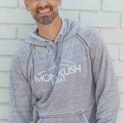 Man wearing Gray MONTKUSH Farms Vintage Zen Fleece Hooded Pullover Sweatshirt
