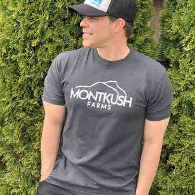Man wearing MONTKUSH Farms Unisex Triblend Short Sleeve Tee