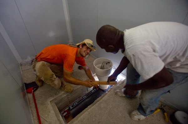Benton Irwin (left), project engineer at Greenwood Restoration, at the Expo for the Building Back Better Communities (BBBC) Housing Project, a government of Haiti program to find solutions to the rehousing of displaced Haitians as a result of the January 2010 earthquake in Port-au-Prince, Haiti, June 14, 2011.