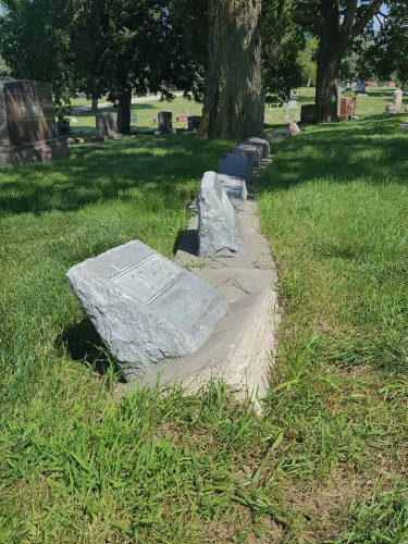 Re-set leaning cemetery monument