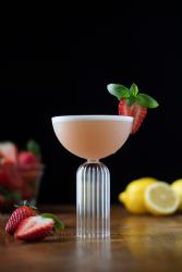 cocktail-garnished-with-strawberry-and-basil-leaf