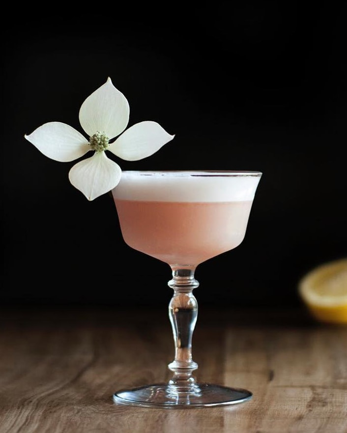 pink-lady-gin-cocktail-with-kousa-blossom-garnish
