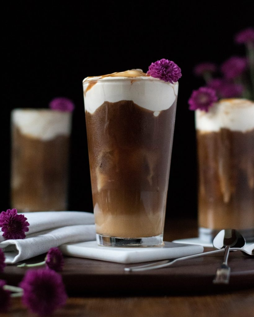 iced coffee with cheese cream floating on top.