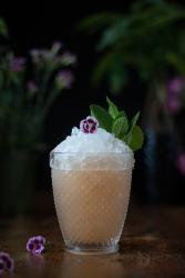orchard mai tai cocktail in a double rocks glass over crushed ice garnished with mint