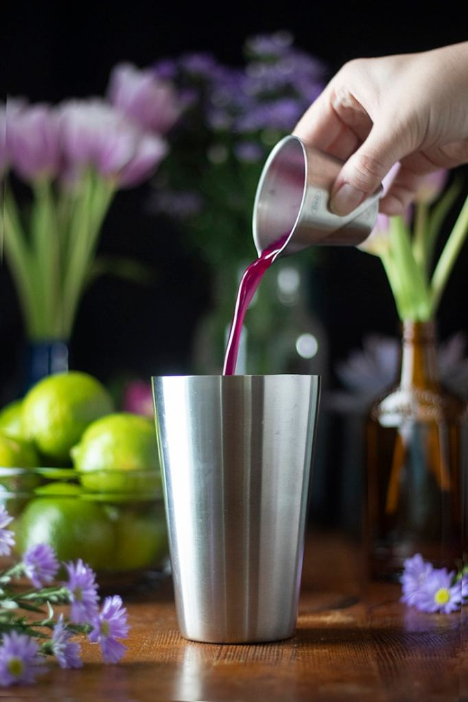 pouring-syrup-into-cocktail-shaker-5695155