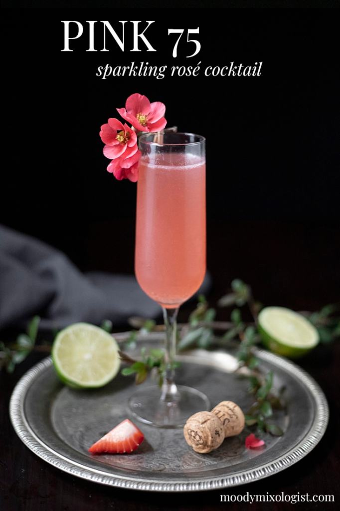 "pink cocktail in a champagne flute on a silver tray with text at the top that says ""Pink 75 sparkling rose cocktail"""