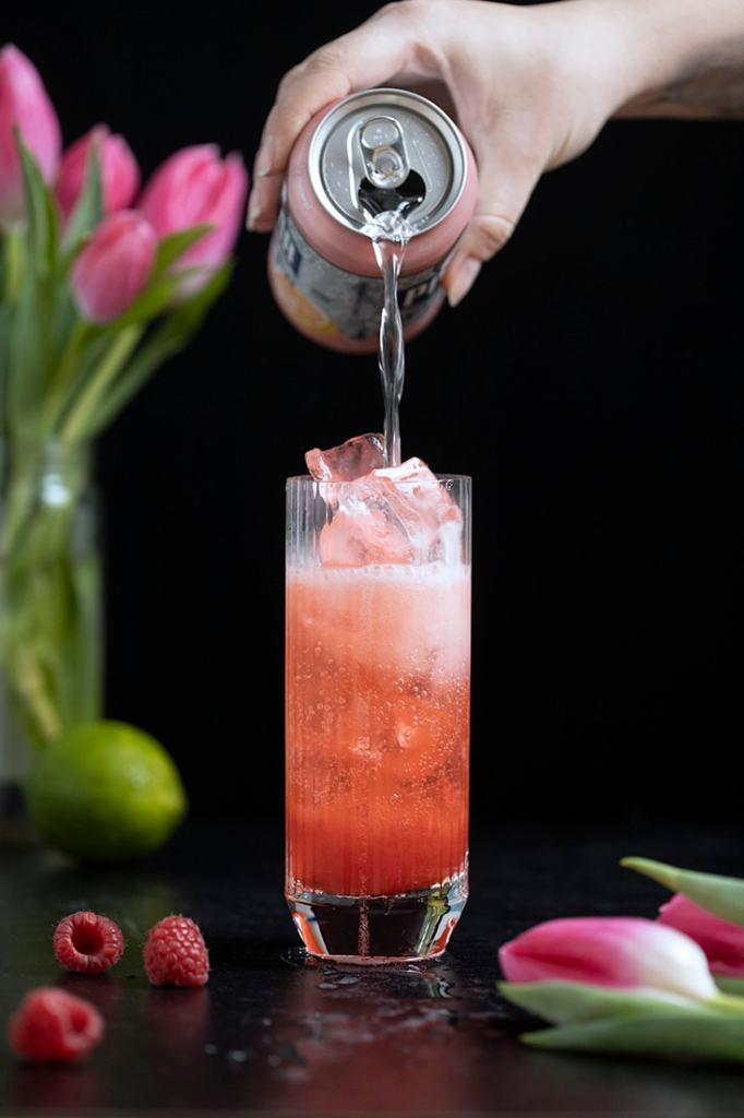 topping a raspberry rickey tall drink with seltzer water