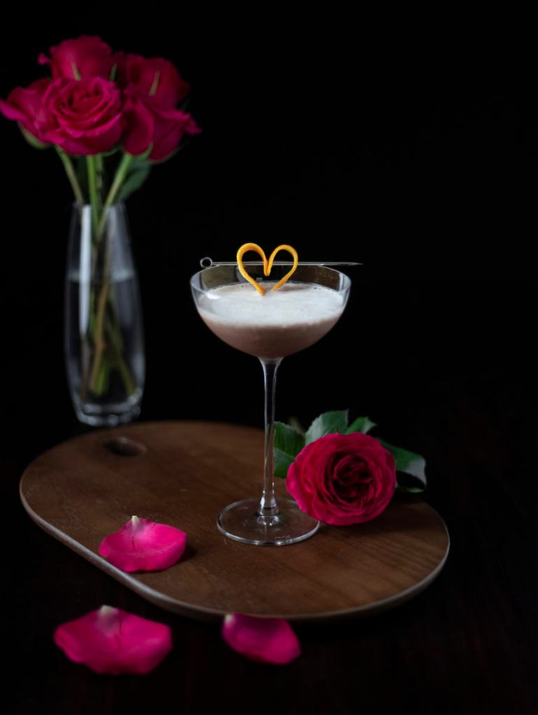 chocolate cocktail with a heart-shaped orange peel garnish