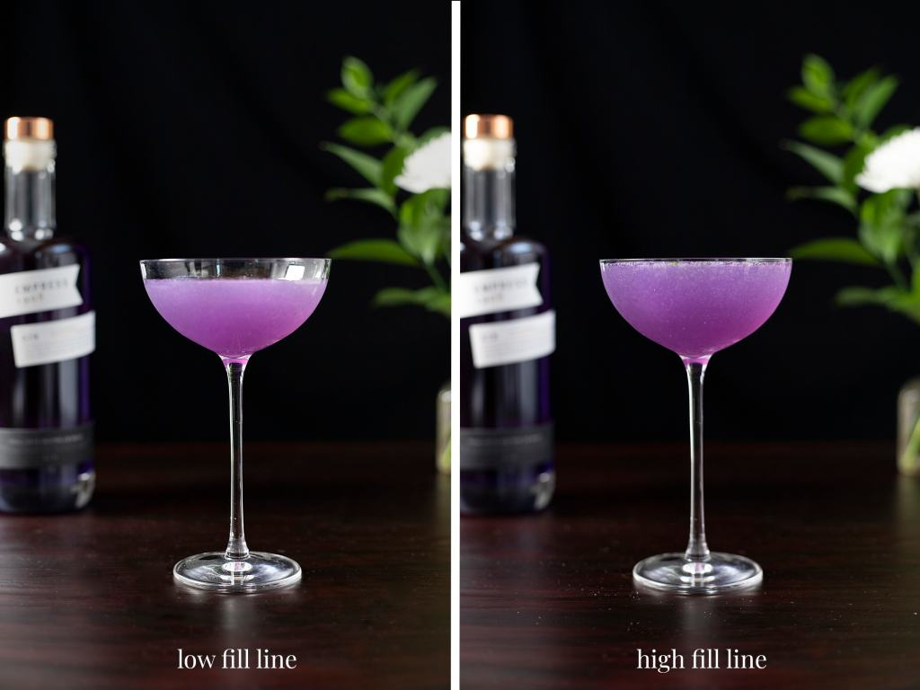 a purple cocktail filling the glass three quarters and a purple cocktail filled to the brim.