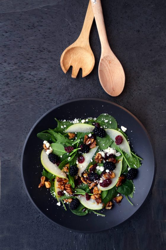 A kitchen witch's pear berry spring goddess bowl with roasted walnuts.