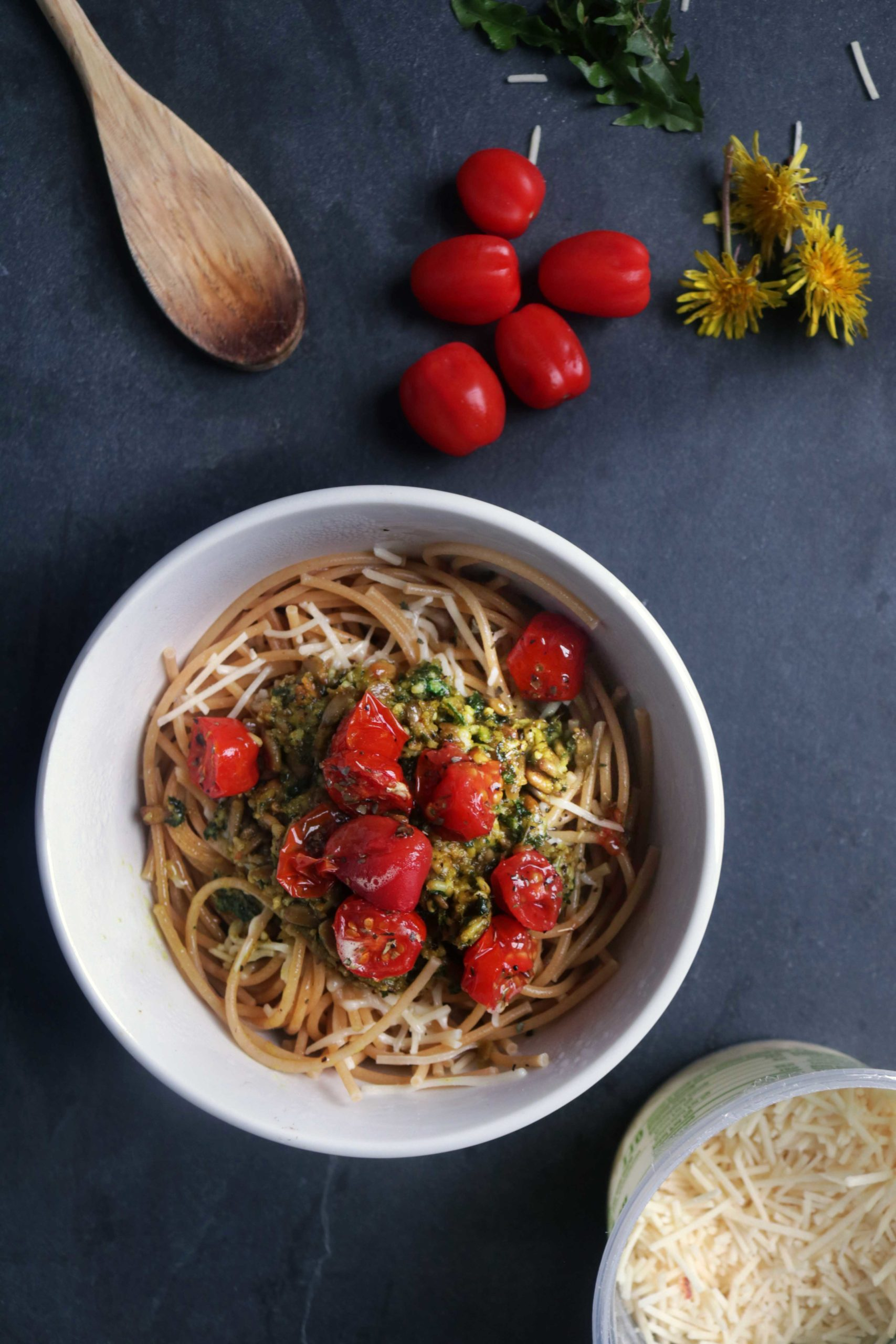 Wildcrafted dandelion pesto with herb roasted tomatoes.