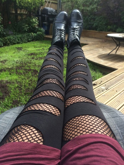 fishnets-beneath-ripped-jeans