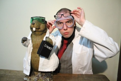 Photo of Kyle Allatt and a beaver doing science
