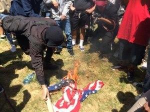 trump-protesters-burn-american-flag-twitter-ajplus-575x431