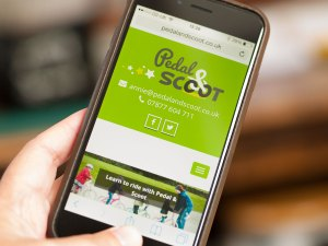Pedal and scoot responsive websitewebsite viewed on a mobile phone