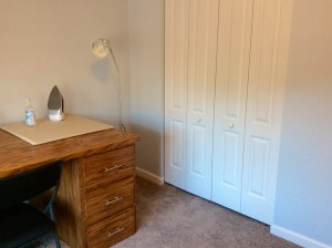 Craft room handmade wood table closet view