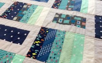 Blue gray modern quilt close piecing detail 2