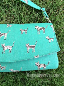 Swoon Glenda Convertible Clutch Cotton and Steel Canvas Teal Metallic Tigers Print Right Side Front