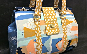 Moore Approved Bound Challenge Art Gallery Fabrics April Rhodes Swoon Patterns Nora Doctor Bag Gold Hardware Front View Angle
