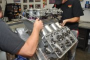 With gaskets glued to the flanges the intake manifold and carburetors are set in position