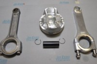 Until five years ago Kaase used titanium connecting rods; today they have been replaced mainly by aluminum. Here shown on the left is an example of a titanium connection rod and on the right the aluminum counterpart. The Diamond Pro Stock piston features inboard pin bosses, stiffening ribs, shorter pins and minimal skirts to decrease frictional loses. Friction is further reduced by the use of thin .8mm top rings and Napier-style second rings. Trend's piston pins are coated in a diamond-like carbon and retained in the piston with single round wire locks.