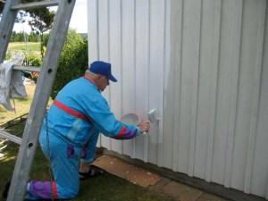 Verweerd hout van tuinhuis schilderen