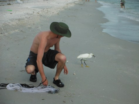 Dave feeding a bird some bait fish
