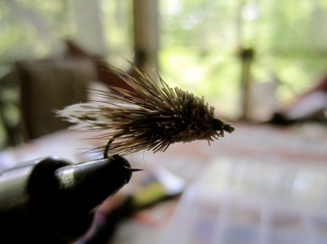 Mini Muddler: Hook: 12 Thread: 70 Brown Denier Tail: Turkey Body: Silver Tinsel Underwing: Snowshoe Rabbit Wing: Turkey Collar: Deer Hair Head: Spun and Trimmed Deer Hair