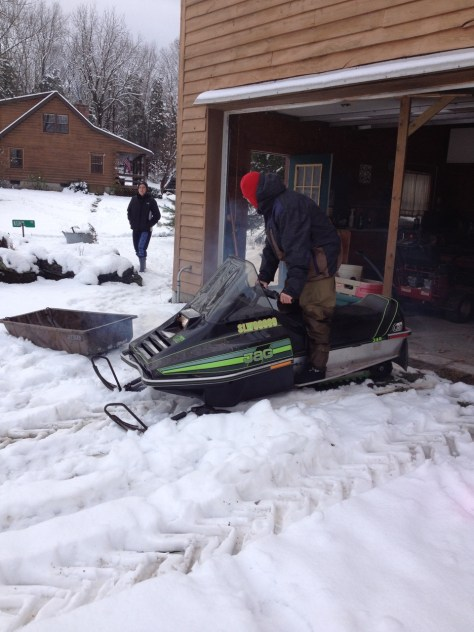 Brenton starts the Arctic Cat on Thanksgiving.