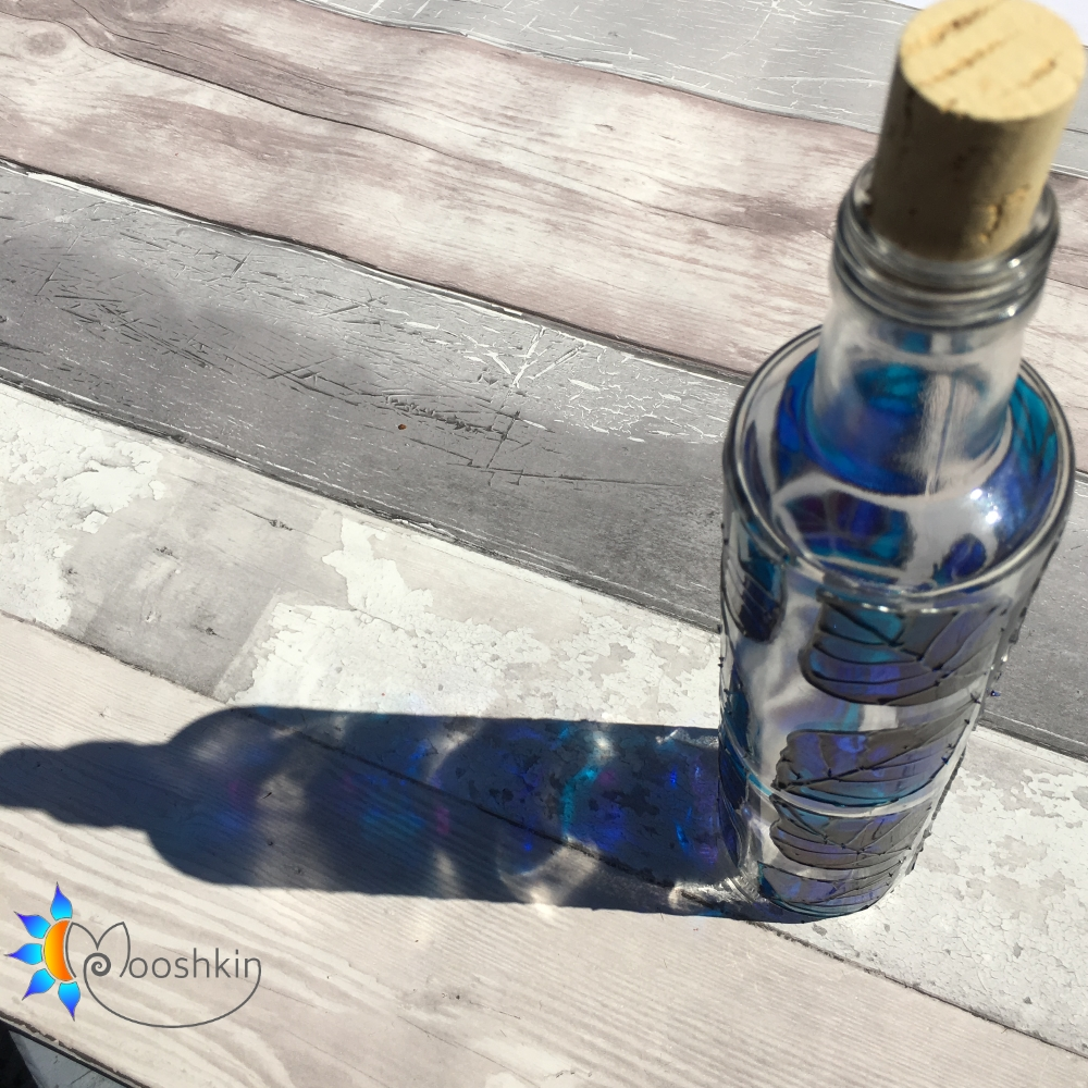 Painted upcycled glass olive oil bottle