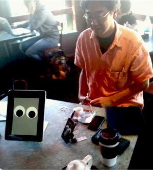 The iPhone abilities are demonstrated at Red Rock Cafe in Silicon Valley by Kazu Terasaki.