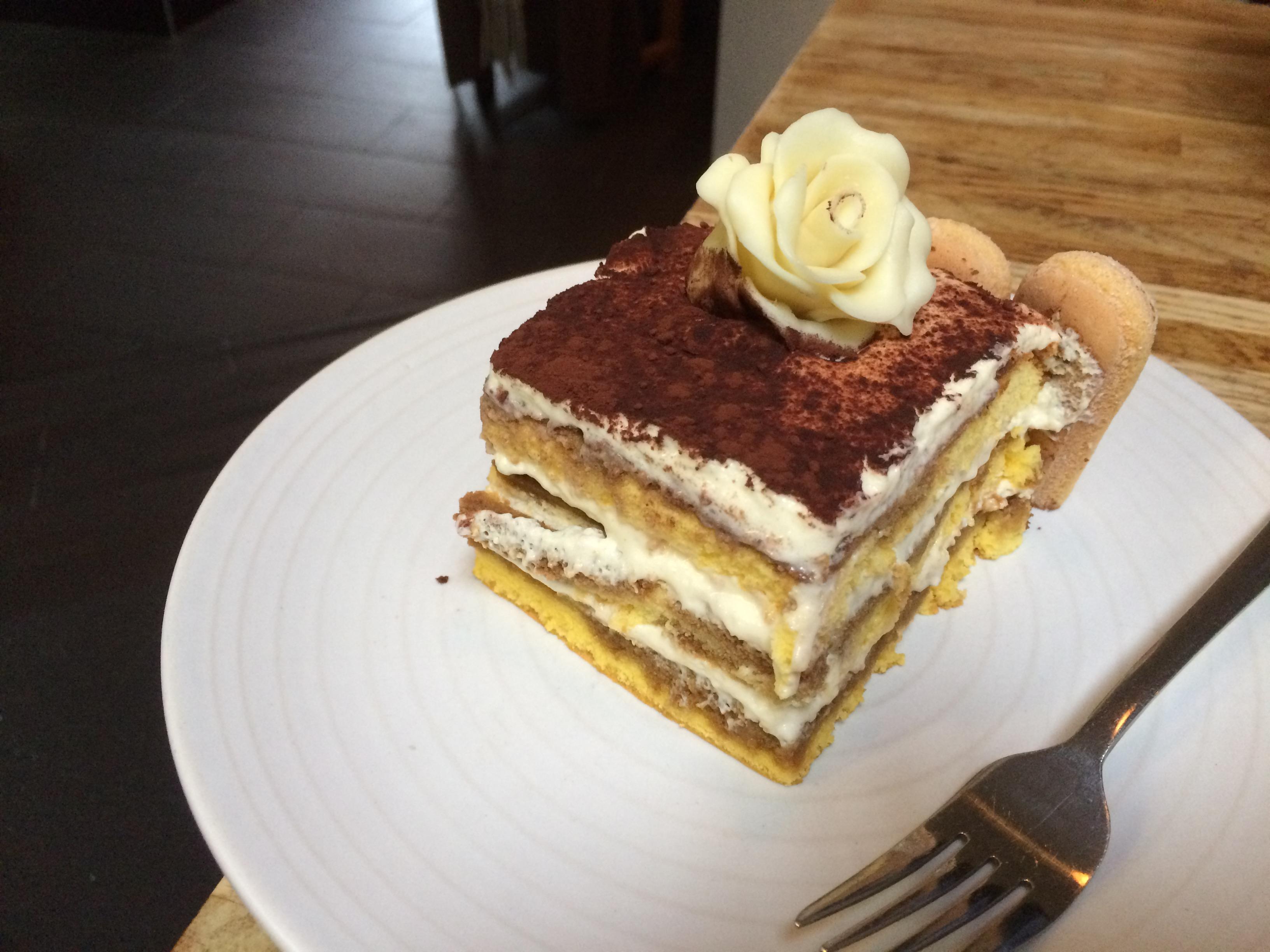 A slice of of a bespoke tiramisu wedding cake for a party