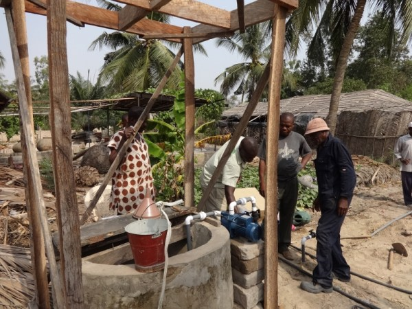 Specialist fixing the pumping machine in Agbozume Village