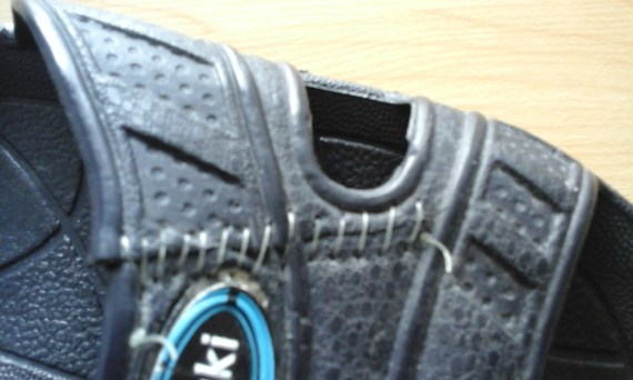 Part of a jandal with sewn stitches