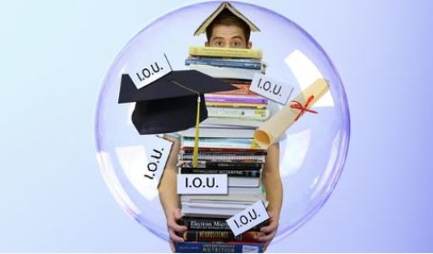 College student holding stack of books