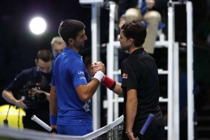 Dominic Thiem bounced back from blowing four match points in a dramatic tie-break in the second set to beat Novak Djokovic in three vibrant sets in the last four at the ATP Finals on Saturday.