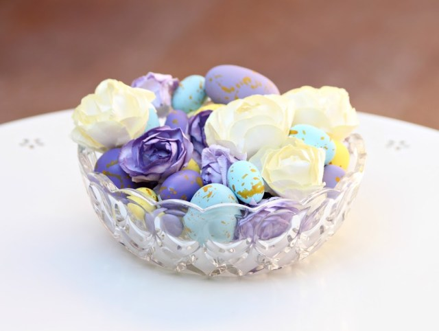 Use pretty paper flowers and wood eggs to create a colorful centerpiece that can be used year after year.