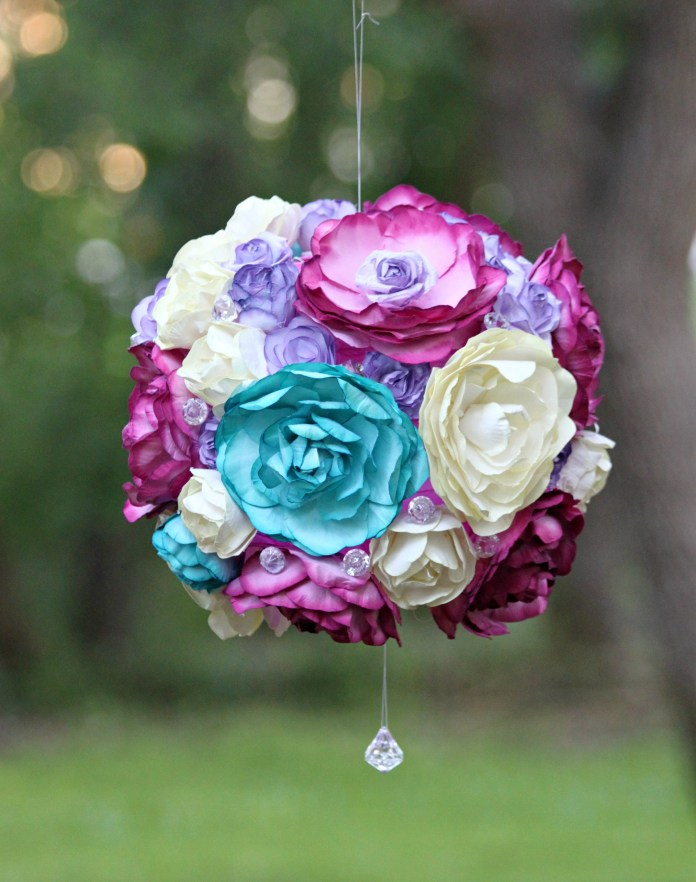 Create a beautiful floral garden party light that is inspired by flower pomanders. This easy to customize project is a beautiful party accent!