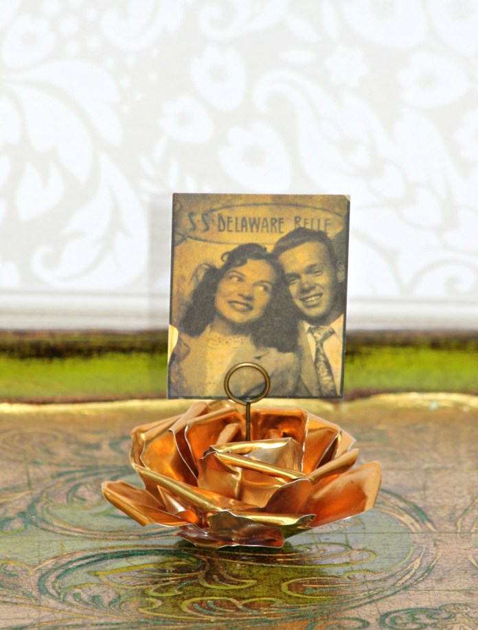 Make metal flower photo holders.