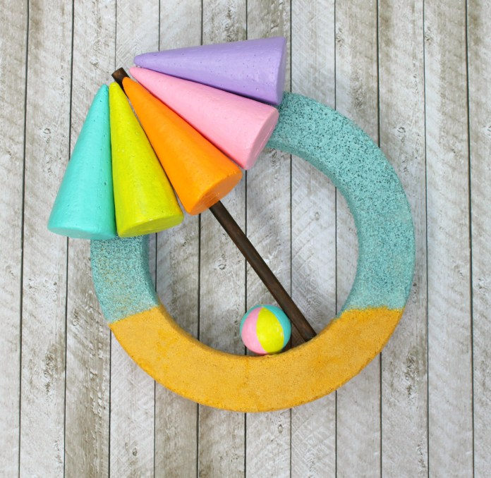 Make a beach themed wreath that is colorful and easy to make.