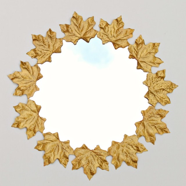 Use dollar store items to create a rich looking faux gold leaf mirror. Use a few common craft items to create a high end look.