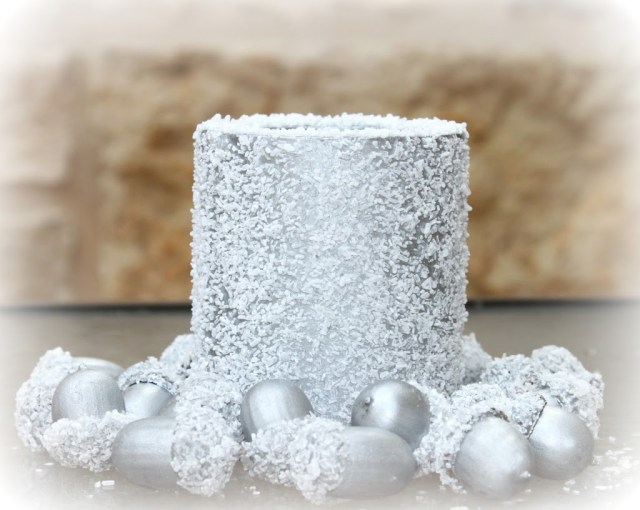 Use craft supplies to make a faux snow covered metallic centerpiece to decorate your home with this winter.
