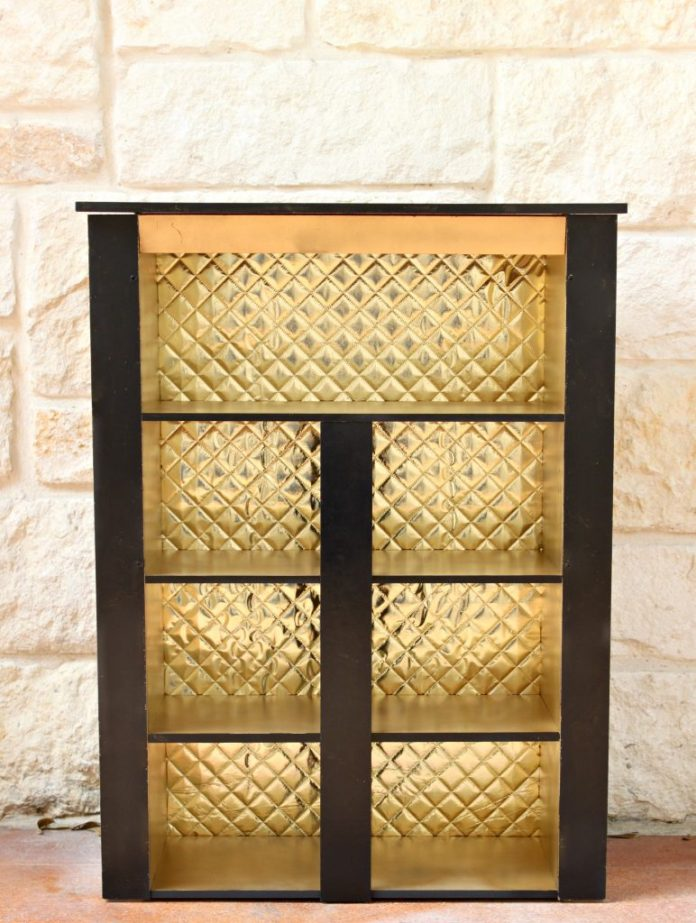 Take a budget cabinet from drab to fab when you give it a makeover with paint and fabric. Easy to follow DIY project.