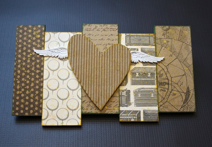 This steampunk style heart with metal wings is a grungy piece of wall art that you can make yourself with supplies from Xyron and Brutus Monroe.