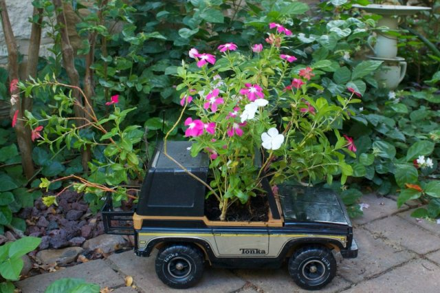 Make toy planters and other fun garden decor using thrift store finds. Why decorate with expensive store bought items when you can make your own?