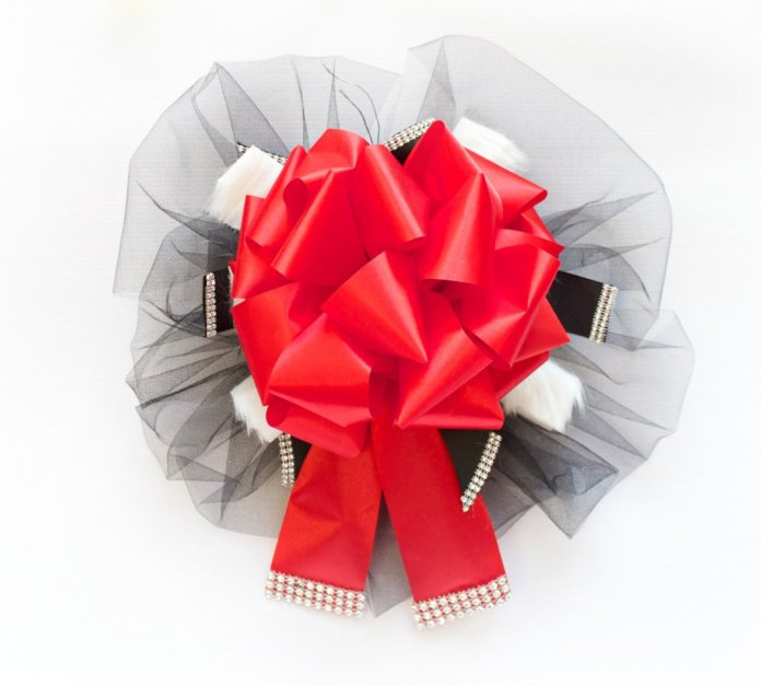 Make an elegant holiday bow using the Bowdabra bow making tool.