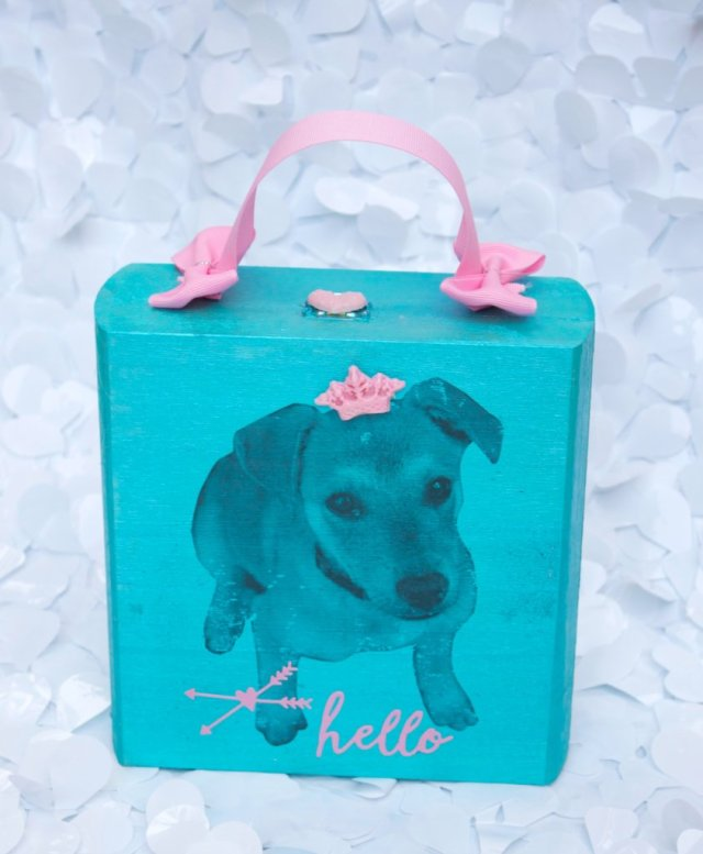 Make the cutest cigar box purse by adding a Mod Podge image transfer of one of your favorite furry friends! This will be your new favorite bag!