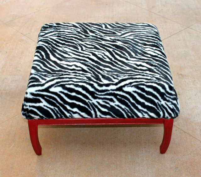 Make a DIY ottoman by transforming thrift store furniture.  In a few simple steps you'll have new furniture for much less than buying new!