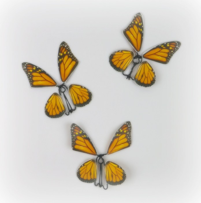 Make a butterfly fidget spinner DIY using a free printable, OnlineLabels.com sticker sheets, and craft wire. This spinning craft is mesmerizing!