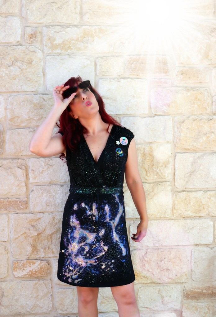 Transform a dress from Goodwill using fabric glitter paints for this awesome galaxy dress DIY.